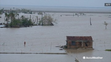 Homes surrounded by floodwaters after cyclone ravishes island