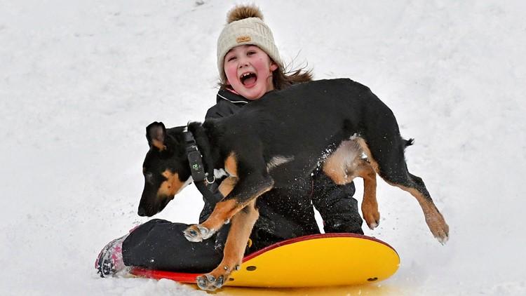 Winter Weather Washington child sledding