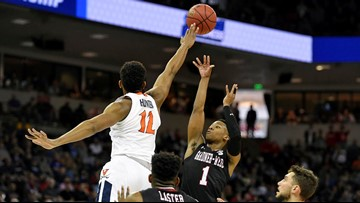No. 1 Virginia avoids 2nd straight huge NCAA tourney upset