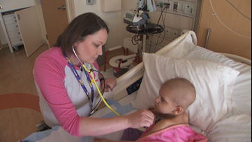 Nurse with incurable cancer stays at bedsides of her young cancer patients