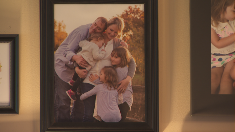 A photo hangs on the wall of Erika Rucks and her family.