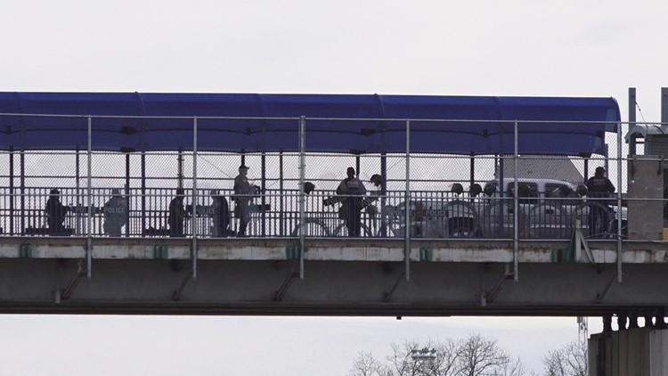 US Customs and Border Protection agents manage a pedestrian queue Eagle Pass Bridge I