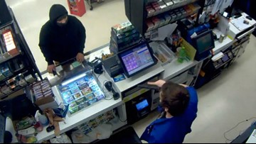 'I'm sorry. I'll leave': Ax-wielding robber one-upped by store clerk's handgun