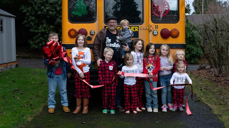 Doug Hayes with his grandchildren in front of the Grandfather Express