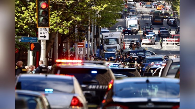 Three Seattle police officers shot, one suspect dead, two in custody