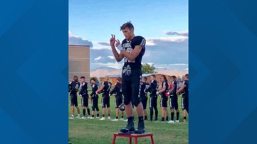 High school football player signs national anthem at home game; video goes viral