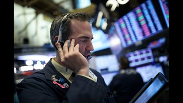 Dow drops more than 450 points as trade, tech worries drag prices down
