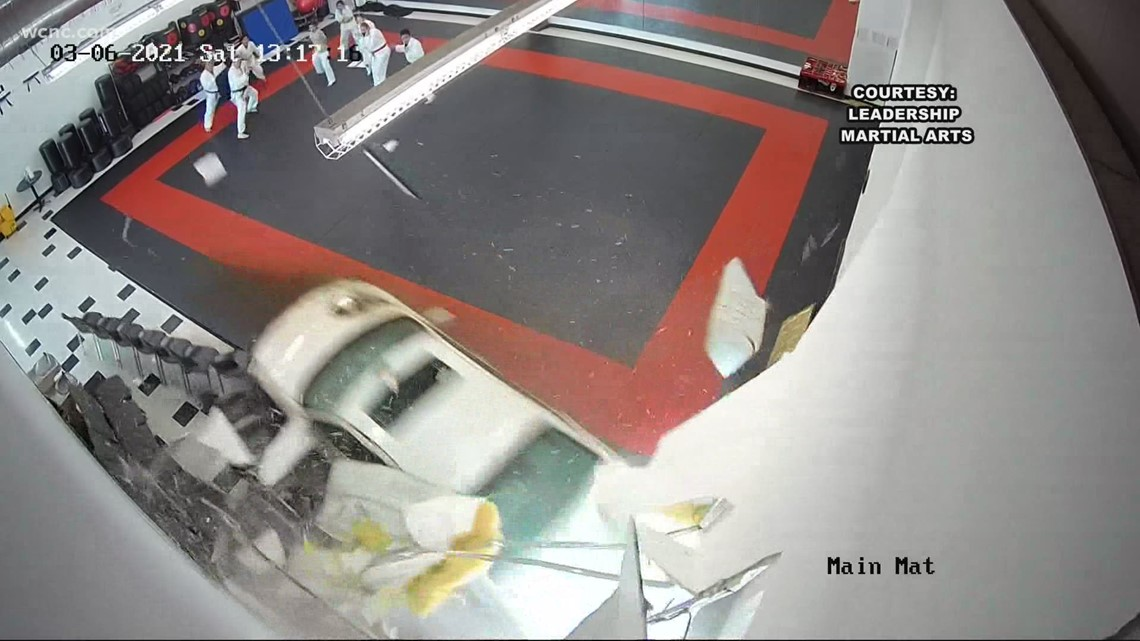 Video shows car crashing into martial arts studio