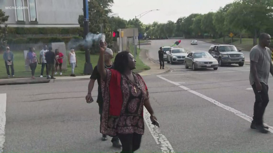 Protestors chant during rush hour traffic in Rock Hill