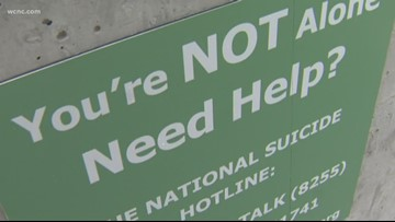 Signs posted in Charlotte aim to prevent suicide
