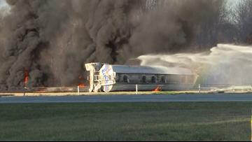 Overturned tanker bursts into flames