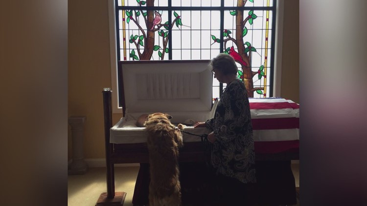 'They bonded; they belonged together'   Dog leans into casket to tell 'Daddy' goodbye