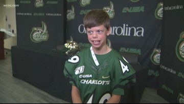Boy with genetic condition surprised by UNC Charlotte football team