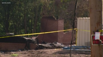 Body found near Charlotte home that caught fire days ago