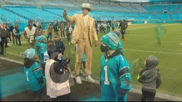 Cam Newton hosts kids from Levine Children's Hospital at Panther's game