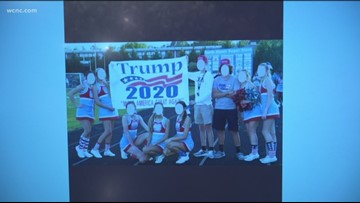 North Carolina cheerleaders on probation after holding up Trump 2020 sign at game