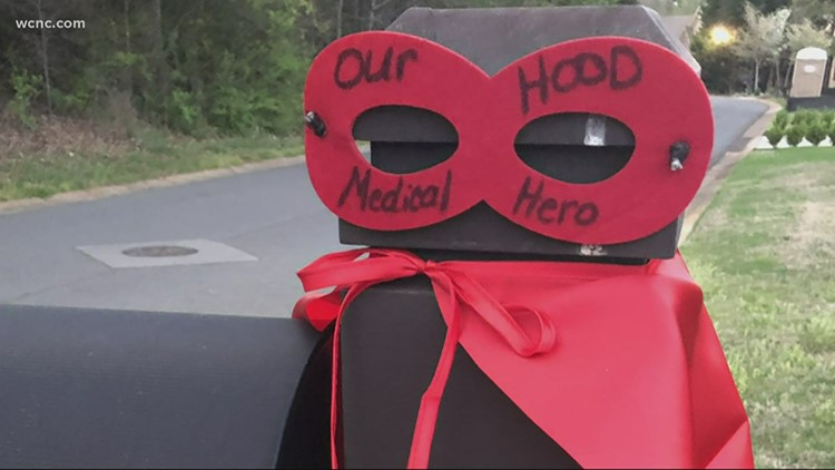 Women honor ER doctor neighbors with superhero capes on mailboxes