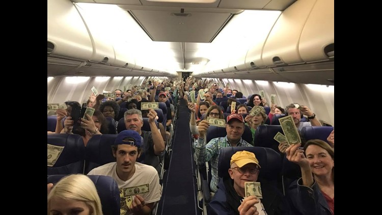 <p>With a long boarding process, little leg room and expensive tickets it seems like there's a lot to complain about when flying these days.But one man's sweet gesture in honor of his father spread love on a North Carolina bound flight, two bucks at a time.</p>