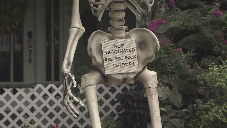 'See you soon, idiots': NC man puts 13-foot skeleton in his yard to encourage vaccinations
