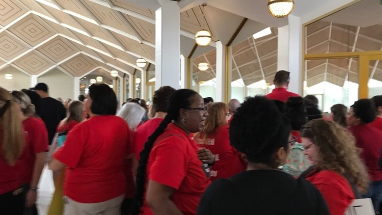 'We vote!' North Carolina teachers walk out for higher pay