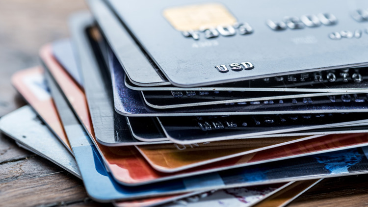 More than half of all Americans carry credit card debt. Here's how to manage your balance better