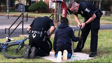 CMPD officers stop to help boy struggling to change his bike tire