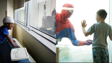 Window washers dress as superheros to surprise patients at Levine Children's Hospital