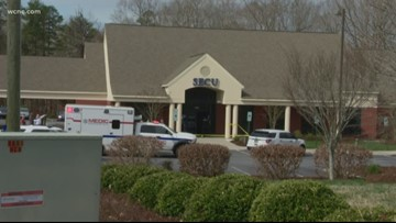 Police: Credit Union security guard fires shots at armed robber