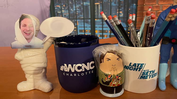 WCNC Charlotte mug displayed on Late Night with Seth Meyers