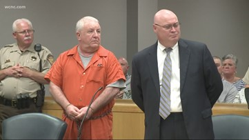 Prominent businessman accused of driving into restaurant, killing family members pleads 'not guilty'