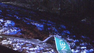 Truck runs off road, crashes down embankment after hitting ice, police say