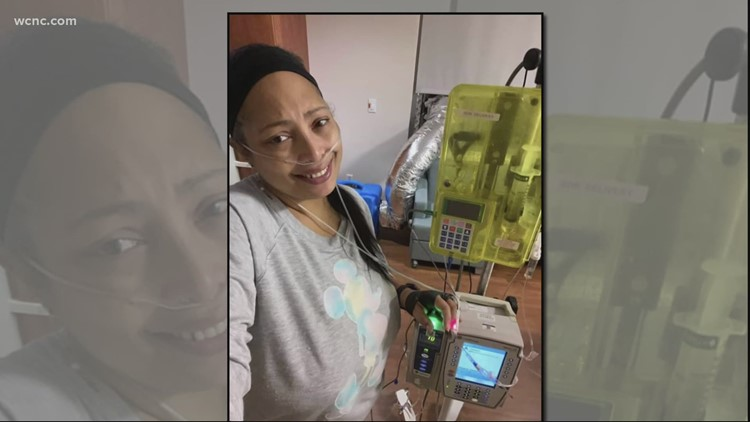 High risk Charlotte woman gets COVID-19 vaccine