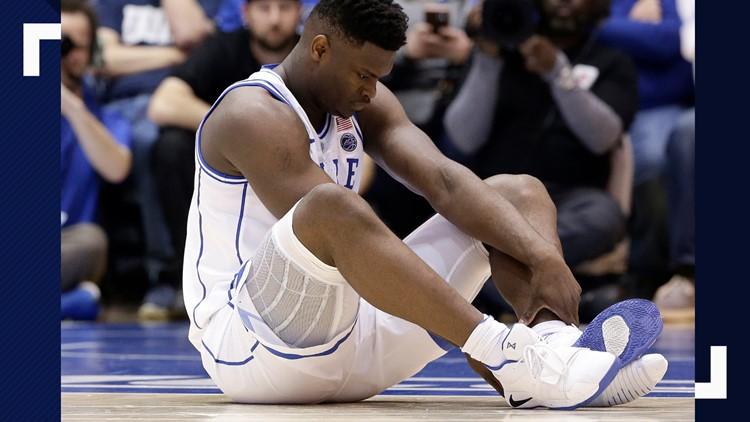 Duke star Williamson injures knee after