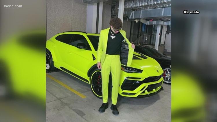 LaMelo sports bright yellow suit to match Lamborghini