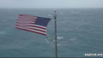 Why is Frying Pan Tower flying the American Flag during a Hurricane?