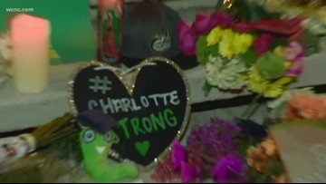 Community gathers for candlelight vigil honoring fallen 49ers