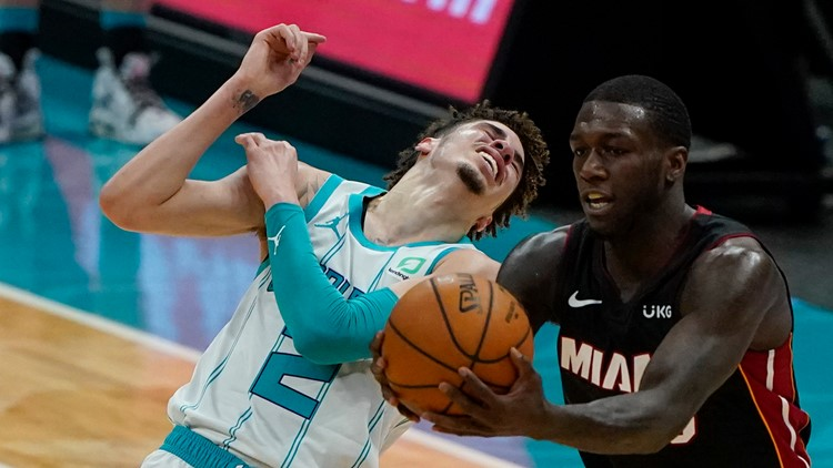 Heat move into 6th place in East; beat Hornets 121-111