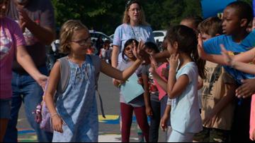 'Go Lexi!' | Police escort 8-year-old cancer survivor back to school