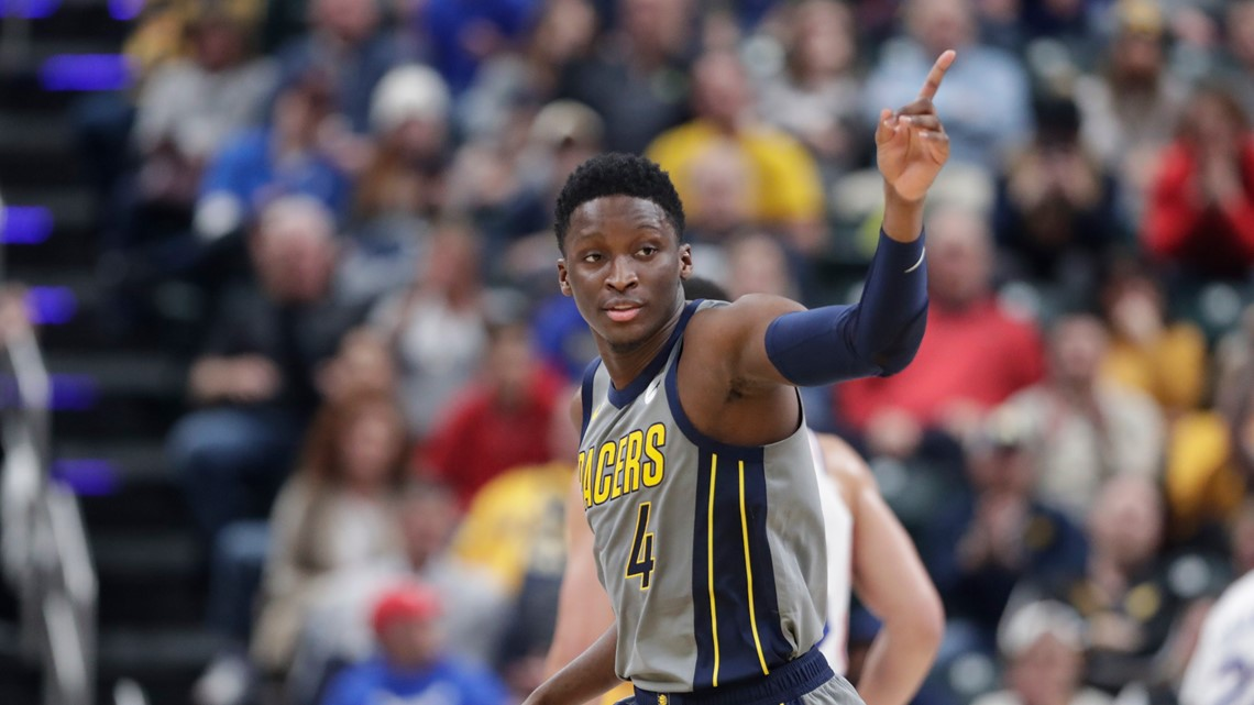 4b3eff27f19 Indiana Pacers guard Victor Oladipo signals a 3-point basket against the  Philadelphia 76ers during the first half of an NBA basketball game in  Indianapolis