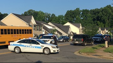 Child running to catch his school bus was hit by a car, police say