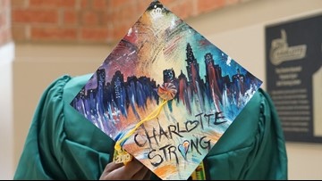 Several students decorate caps honoring UNC Charlotte shooting victims during commencement ceremonies