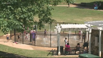 A Charlotte mom says she was attacked by another mom after her son splashed a girl at a Dilworth splash pad