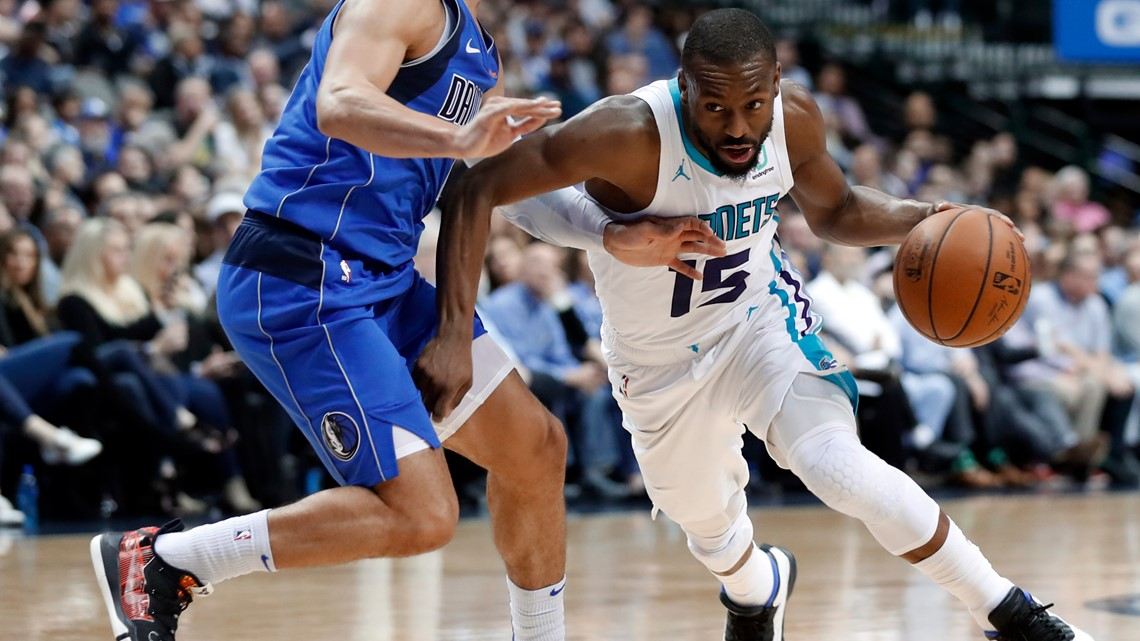 f9e683358 Dallas Mavericks guard Jalen Brunson (13) defends as Charlotte Hornets  guard Kemba Walker (15) works for an opening to the basket during the first  half of ...