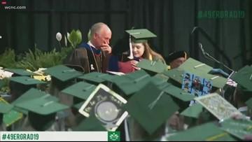 CharlotteStrong: UNCC shooting survivor gets diploma, standing ovation