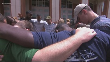 'Just complete devastation'   | UNCC students come together through prayer  while mourning