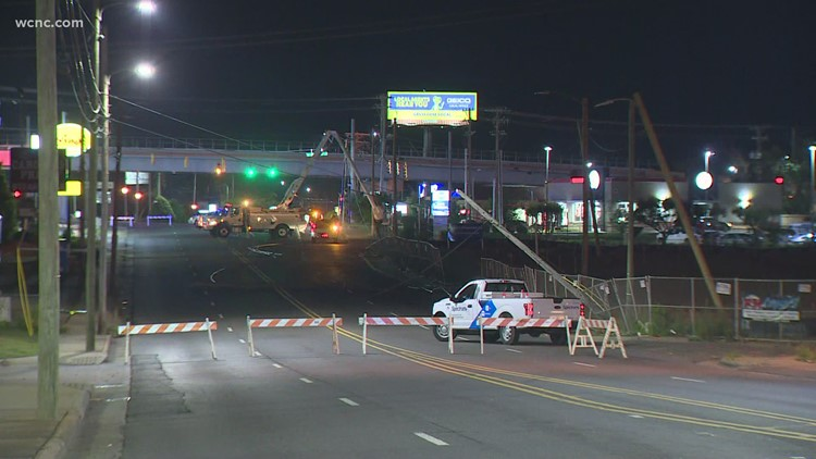 Woodlawn Road closed after crash knocks down power poles