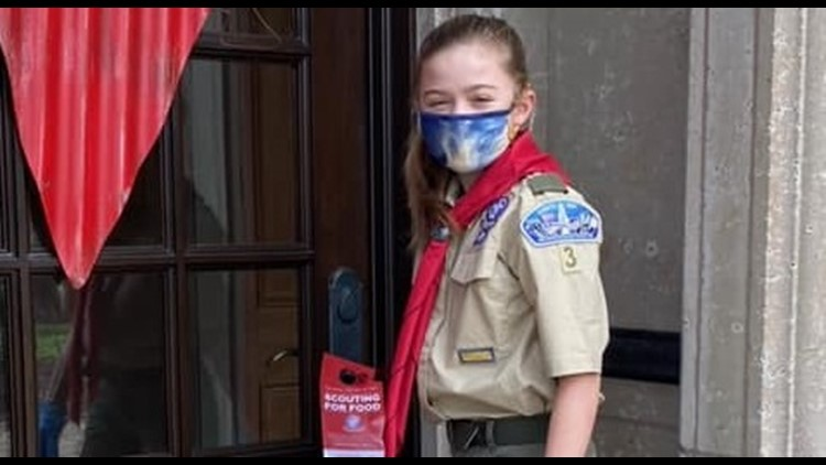 Scouts deliver door tags ahead of Scouting For Food
