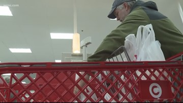 Last-minute shoppers take to the stores before Christmas