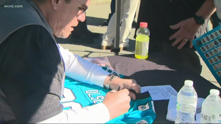 Humane Society of Charlotte, Rivera family team up for Panthers Gear Yard Sale