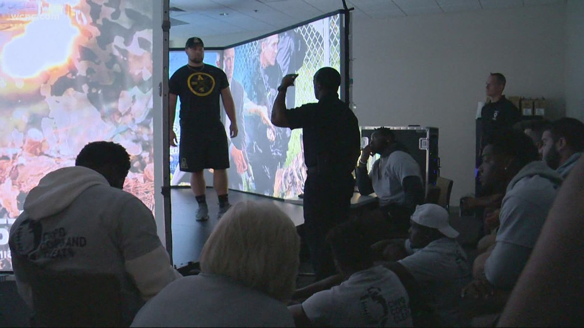 Reasons to smile: CMPD hosts App State football team for 'Cops and Cleats event